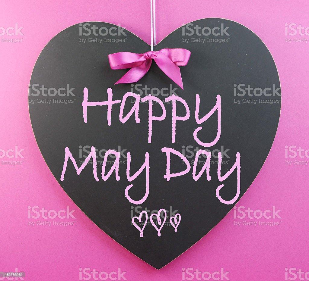 Happy May Day handwriting greeting on heart shaped blackboard stock photo