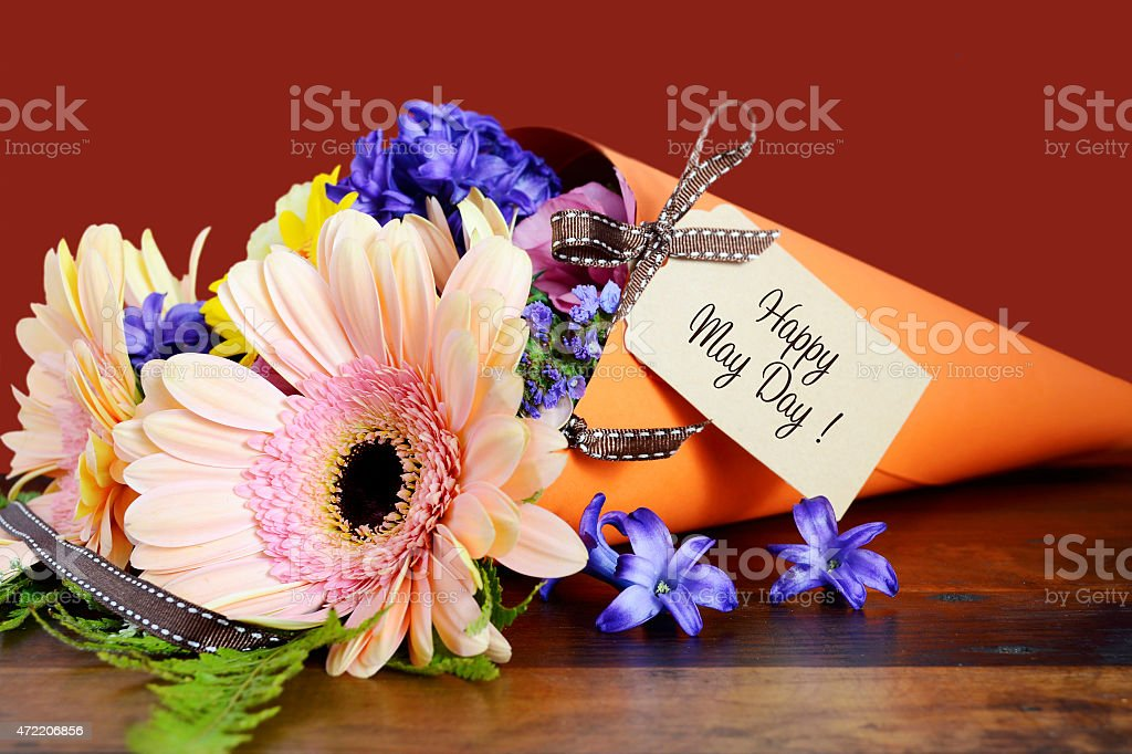 Happy May Day traditional gift of Spring Flowers. stock photo