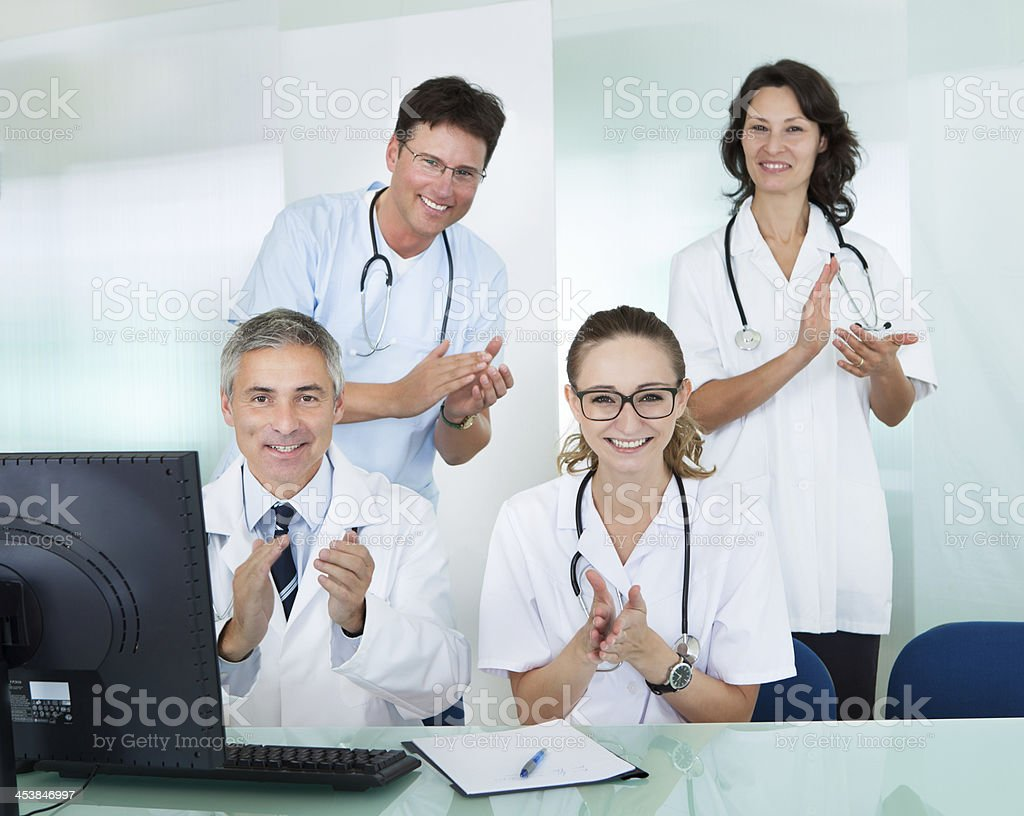 Happy medical team giving a thumbs up royalty-free stock photo