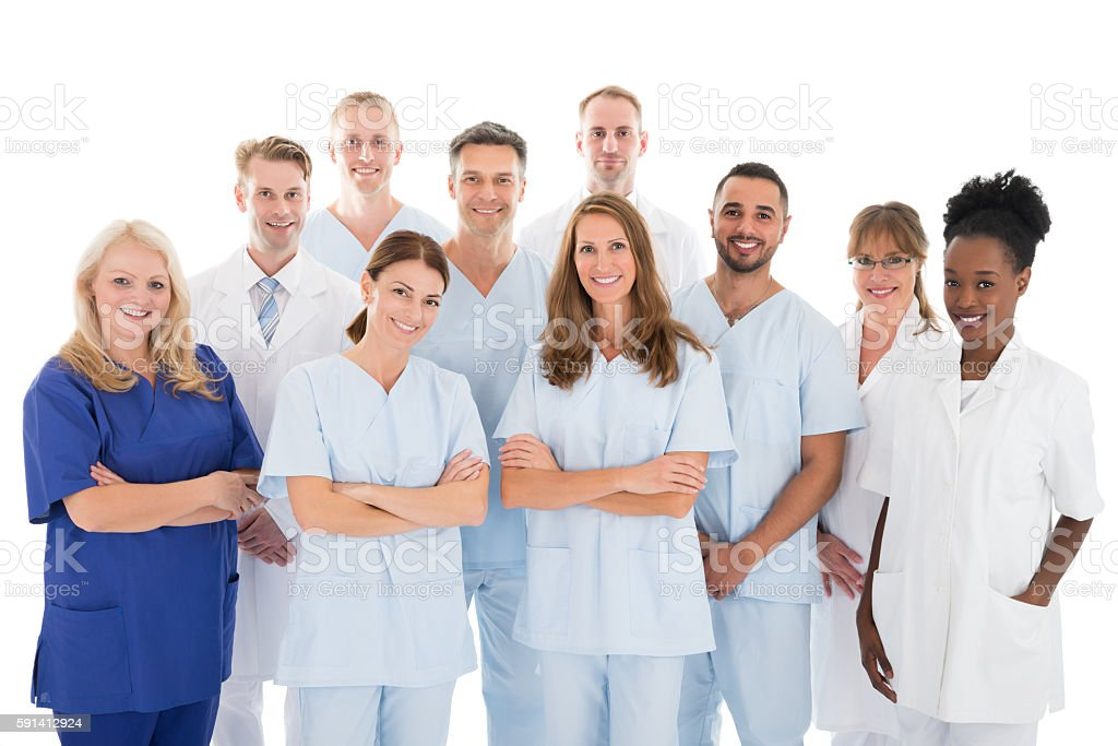 Happy Medical Team Standing Against White Background stock photo