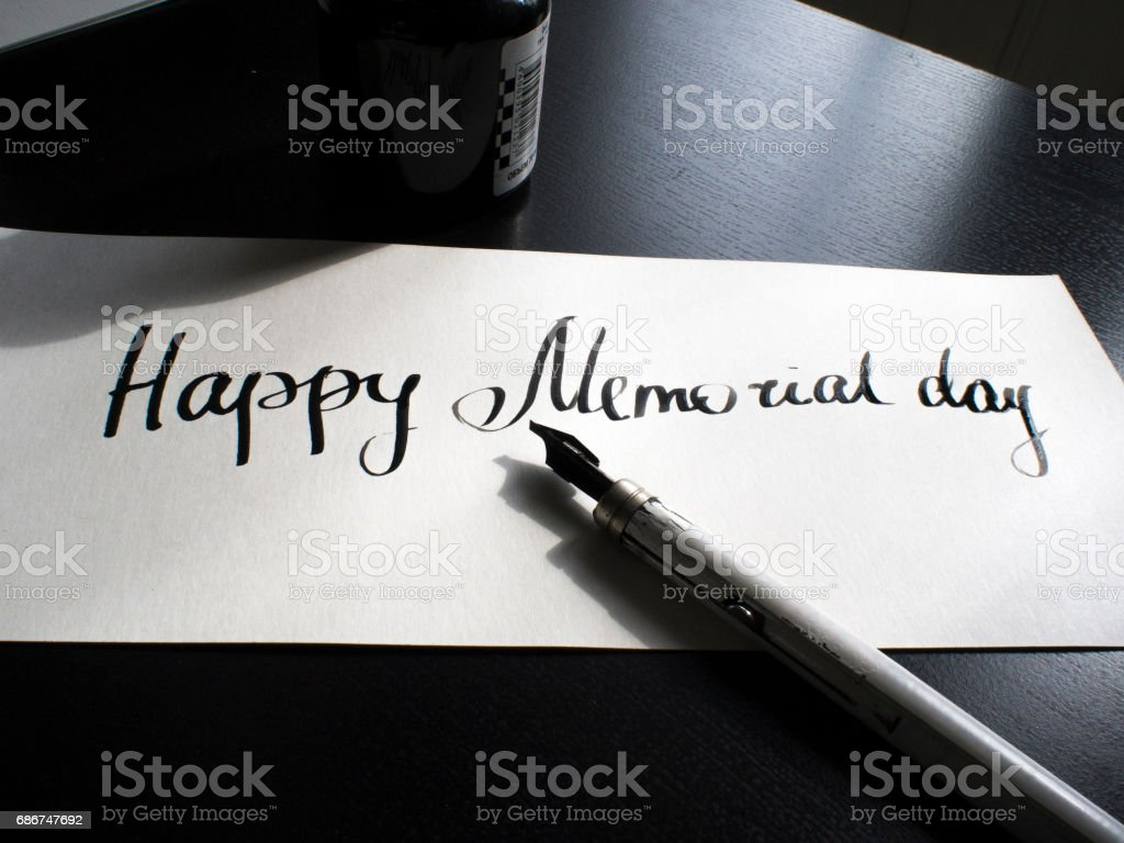 Happy Memorial day calligraphy and lettering post card. Perspective view. The first hard stock photo