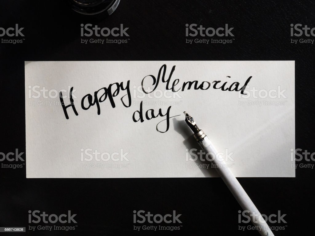 Happy Memorial day calligraphy and lettering post card. Top view. A semicircular inscription stock photo