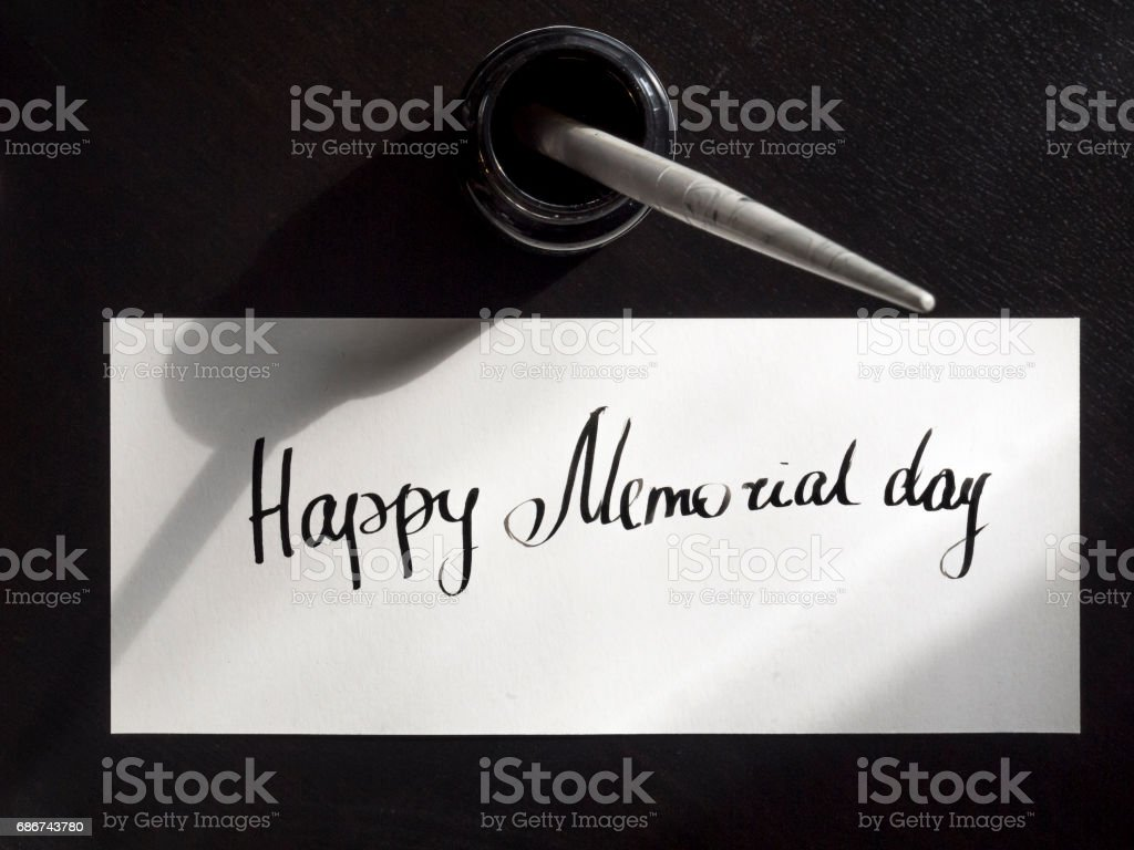 Happy Memorial day calligraphy and lettering post card. Top view. The first hard stock photo