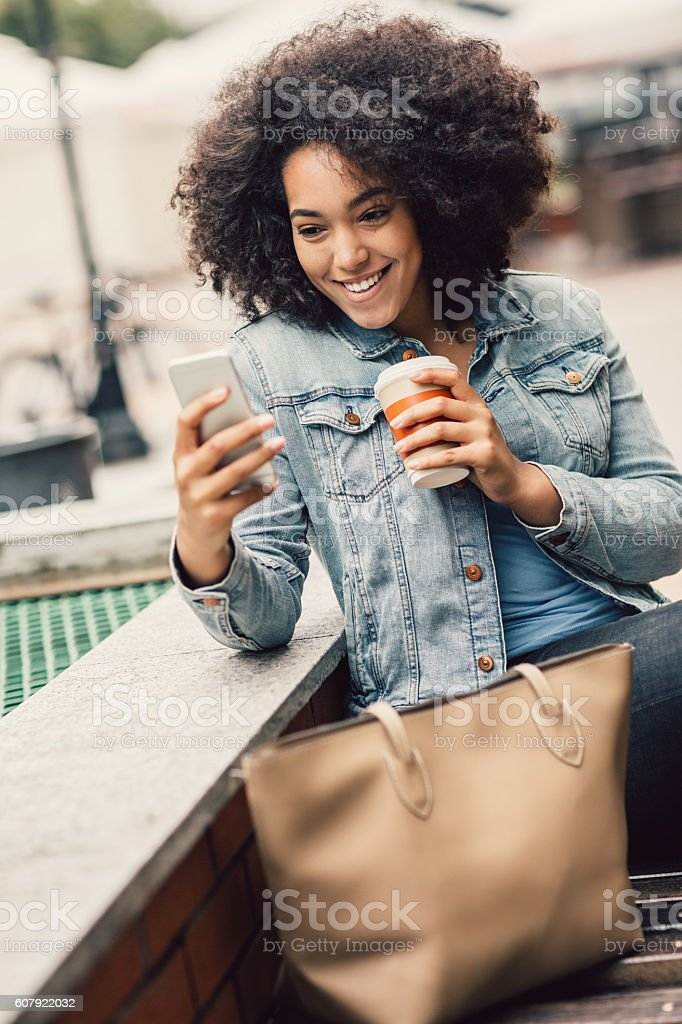 Happy messaging in the city stock photo