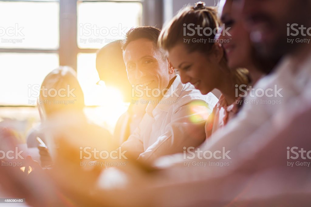 Happy mid adult businessman on a meeting in the office. stock photo