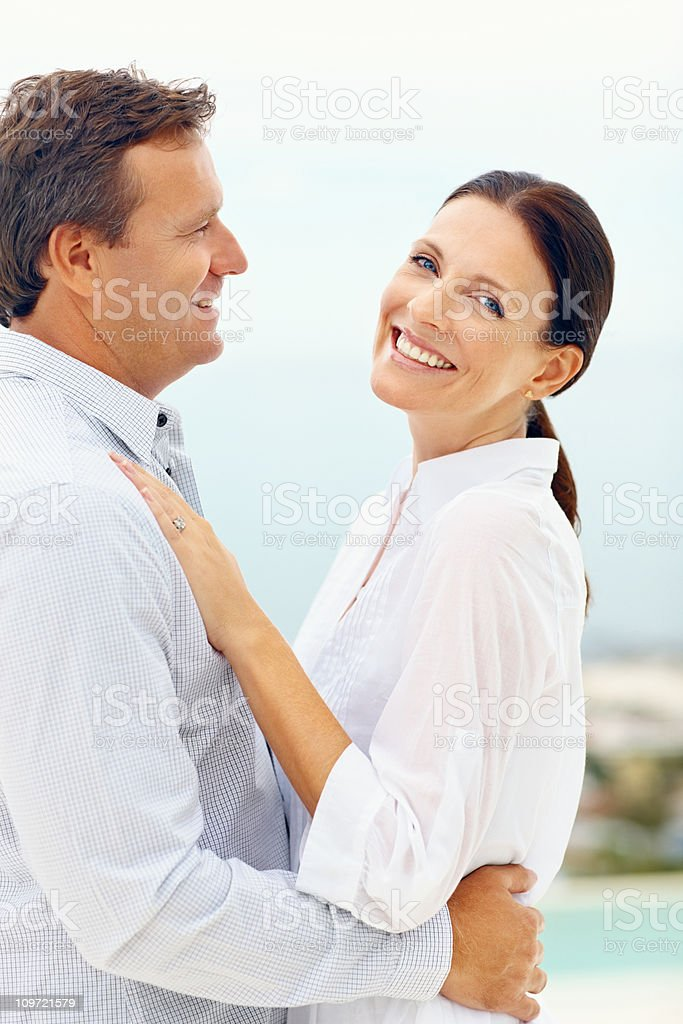 Happy mid adult lady embracing her husband royalty-free stock photo