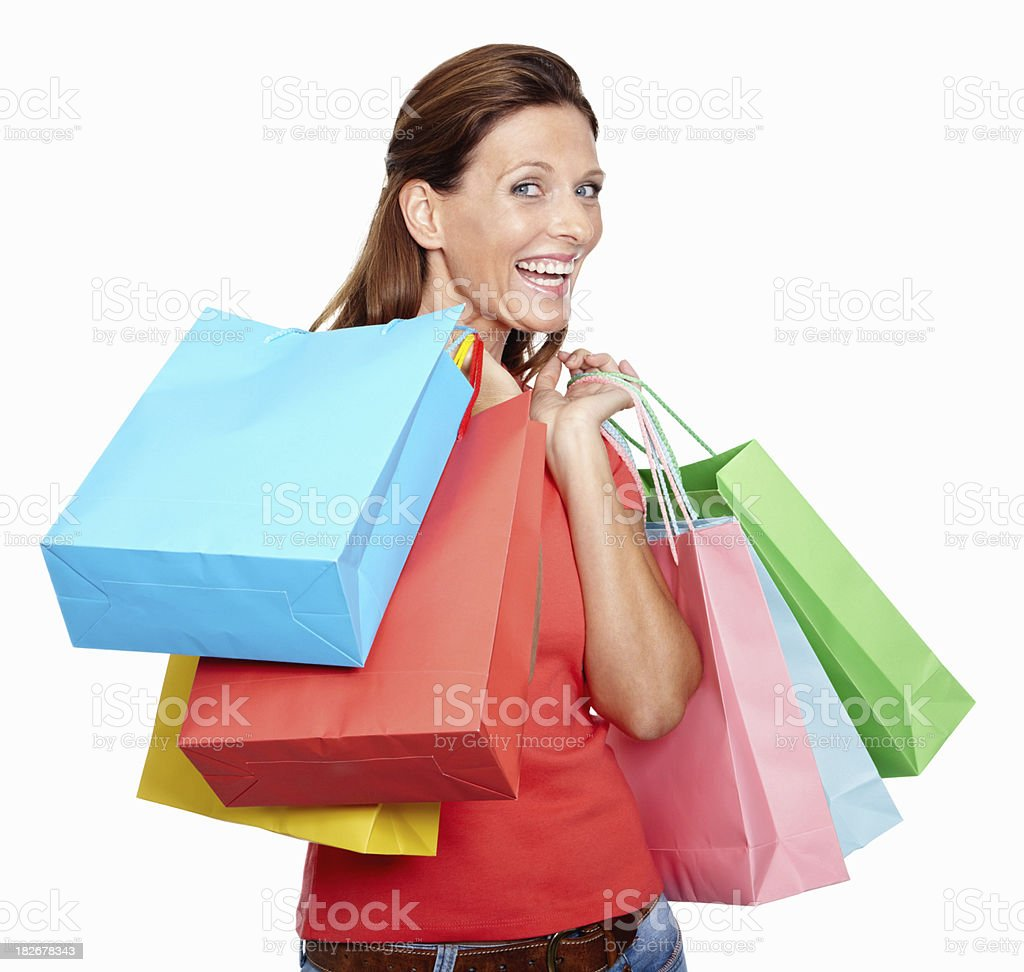 Happy mid adult lady with shopping bags on white royalty-free stock photo