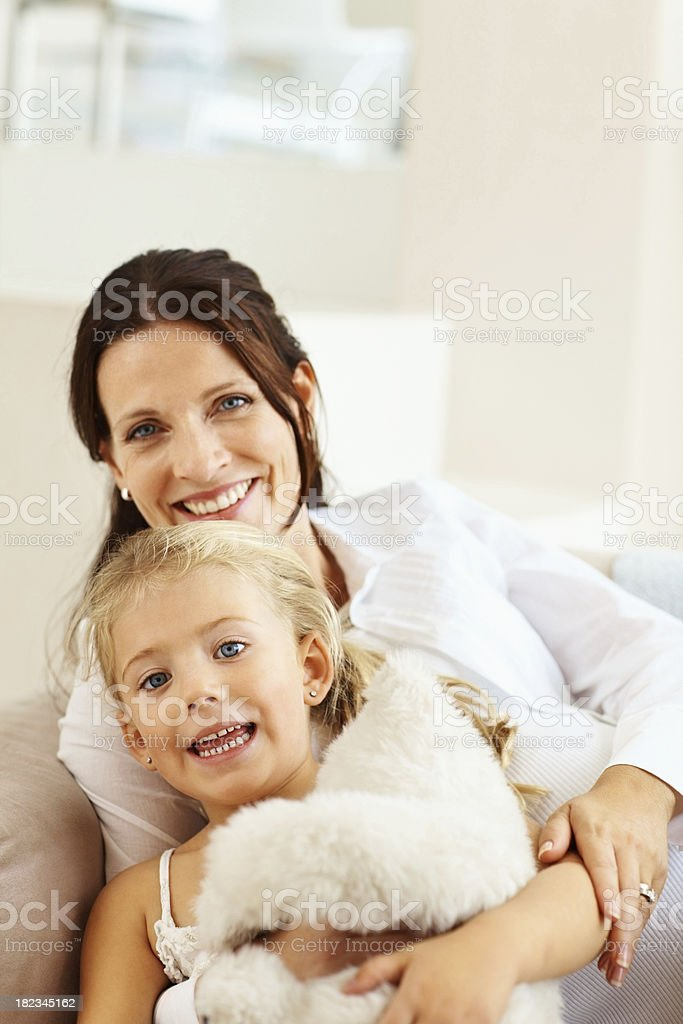 Happy mid adult mother sitting with her daughter royalty-free stock photo