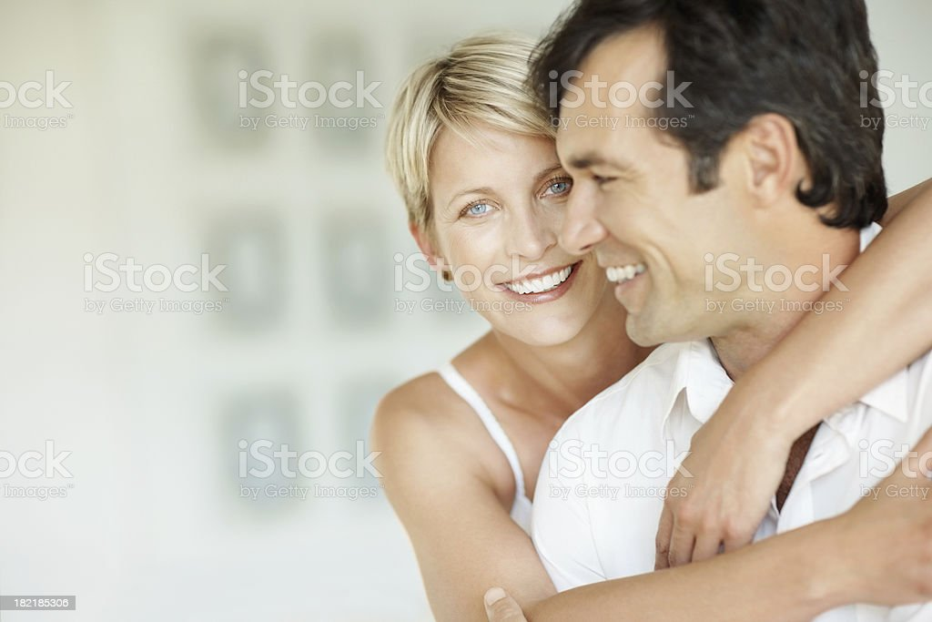 Happy mid adult woman embracing her husband stock photo