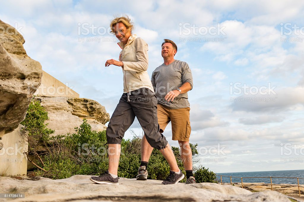 Happy Middle Aged Active Fit Healthy Beach Couple Hiking Outdoors stock photo