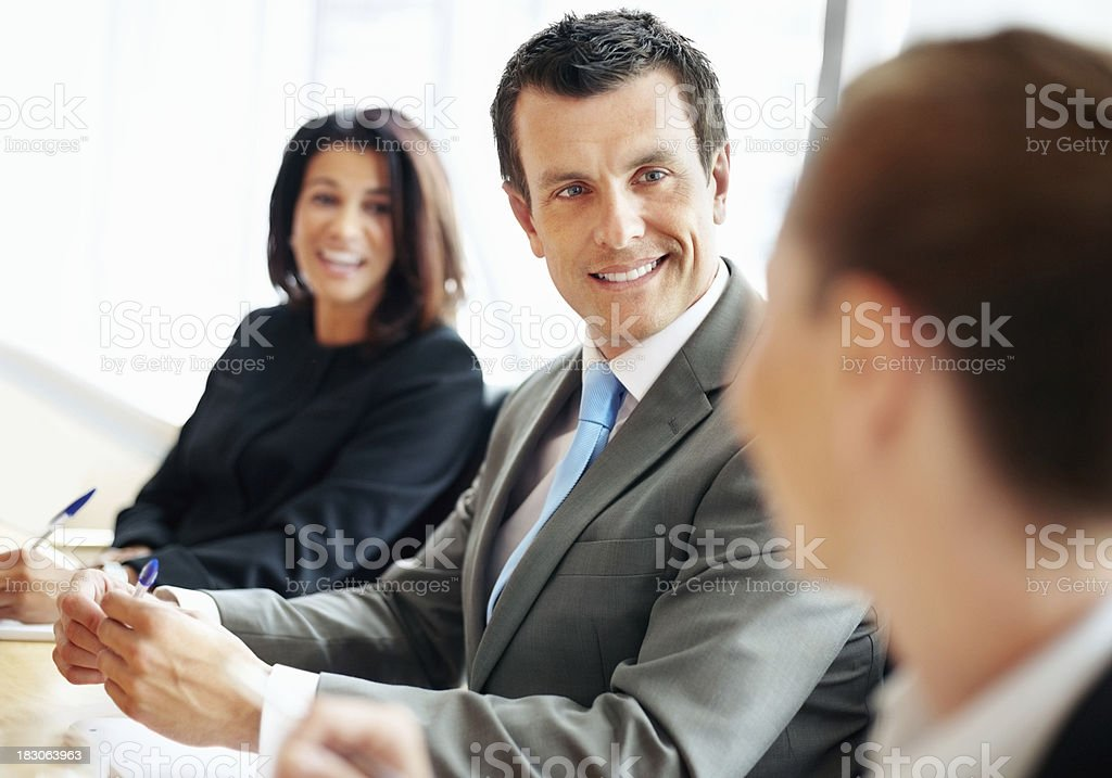 Happy middle aged business man with her colleagues in meeting stock photo