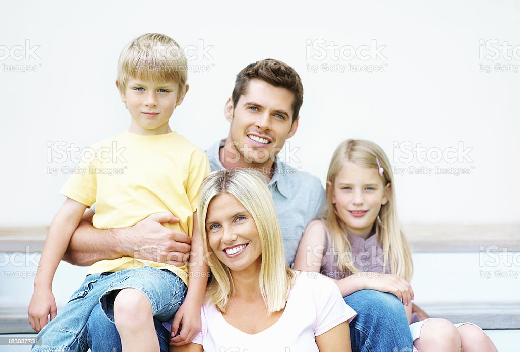 Happy middle aged couple sitting together with their kids royalty-free stock photo