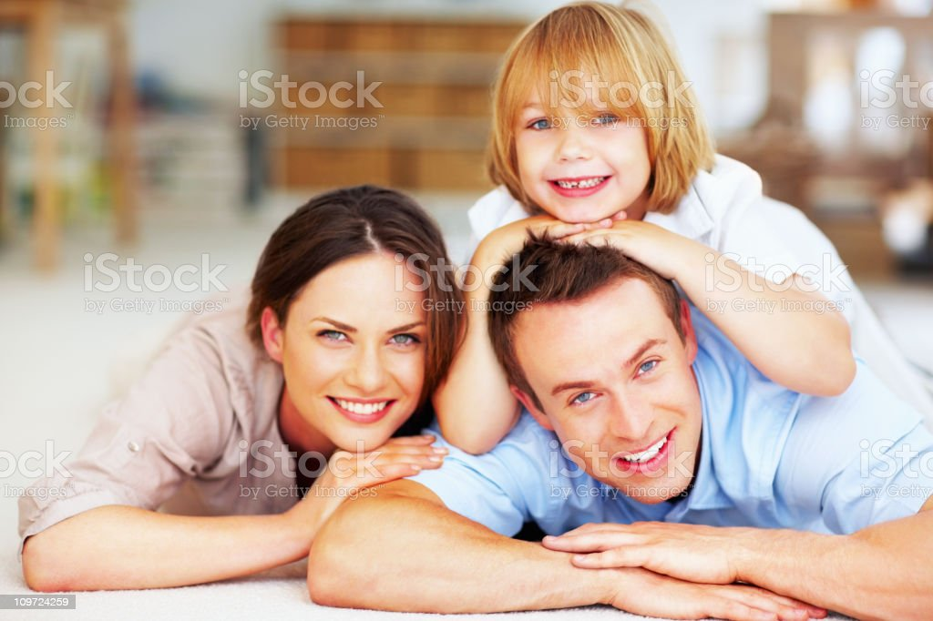 Happy middle aged couple with their son royalty-free stock photo