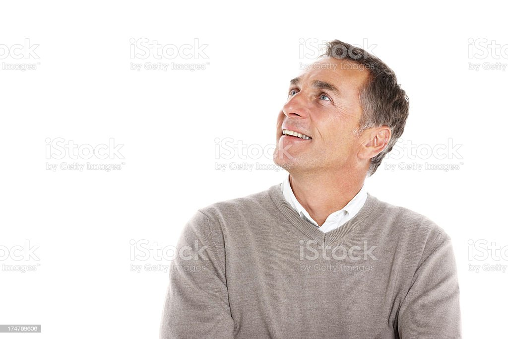 Happy middle aged guy looking at copyspace and smiling royalty-free stock photo