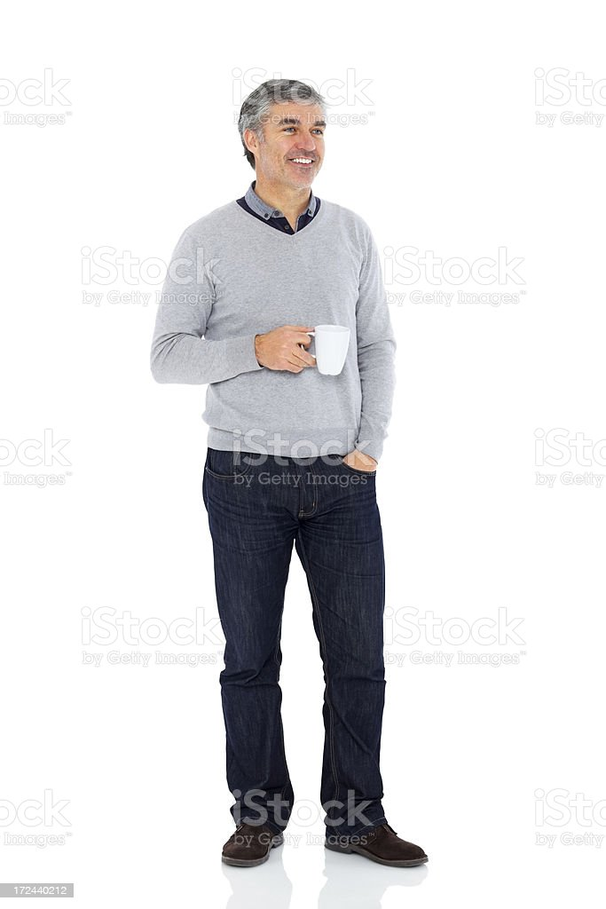 Happy middle aged man with a coffee cup royalty-free stock photo