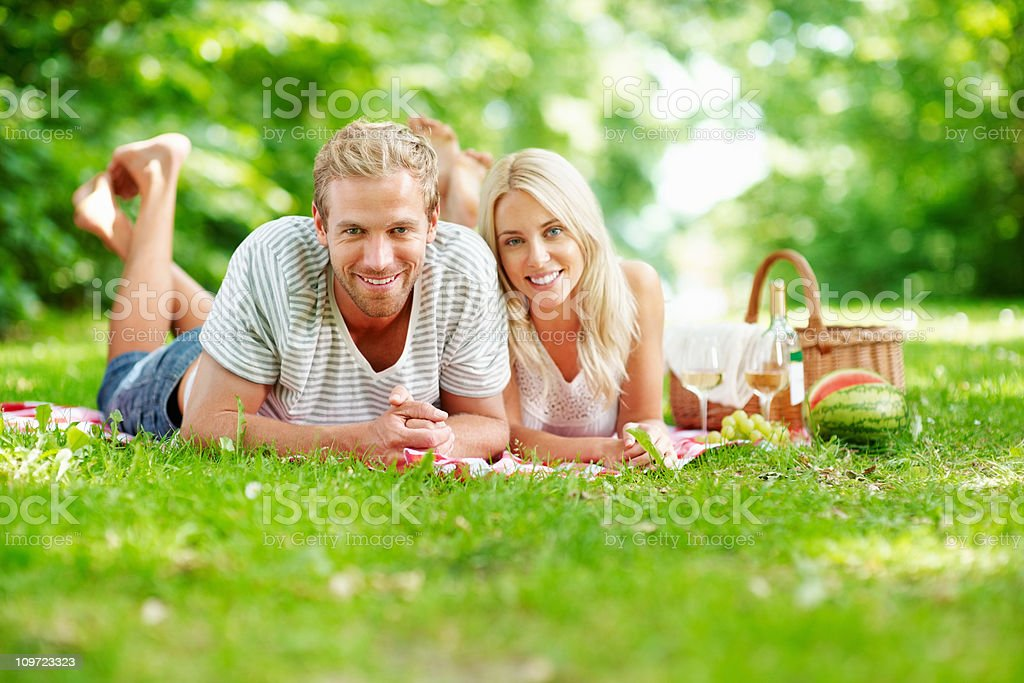 Happy middle aged man with a woman having picnic royalty-free stock photo
