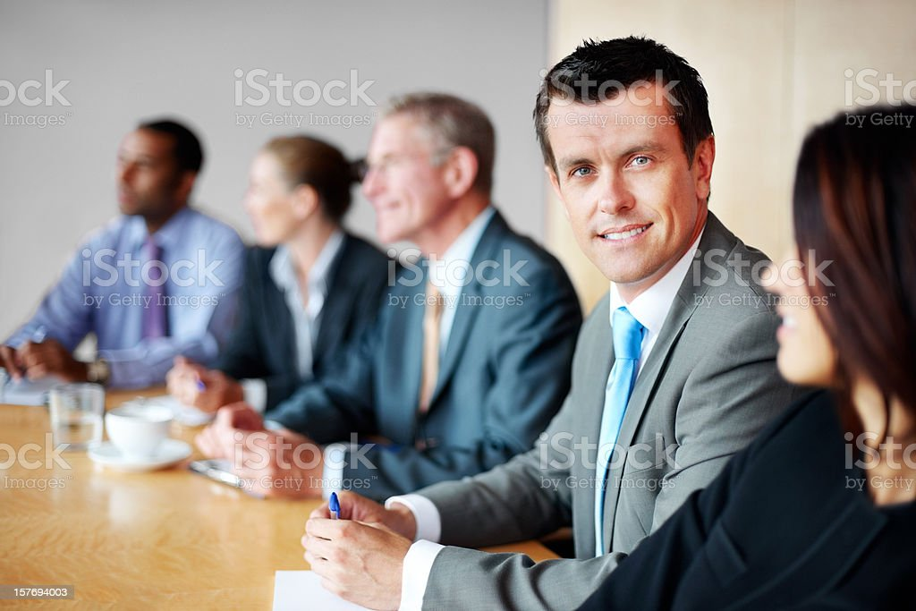 Happy middle aged man with his team in a meeting royalty-free stock photo