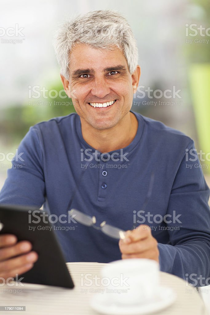 happy middle aged man with tablet computer royalty-free stock photo