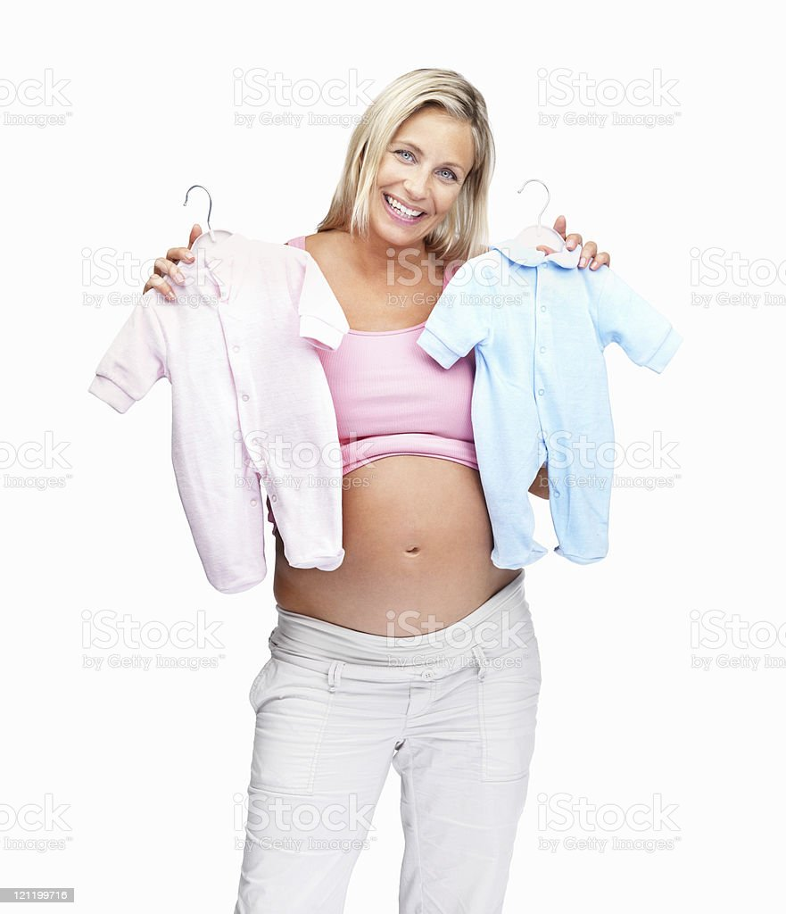 Happy middle aged pregnant woman holding a baby clothes royalty-free stock photo