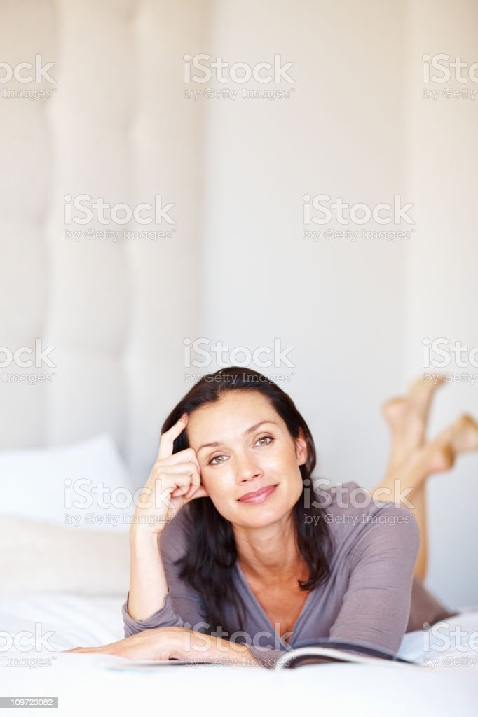Happy middle aged woman reading book - copyspace royalty-free stock photo