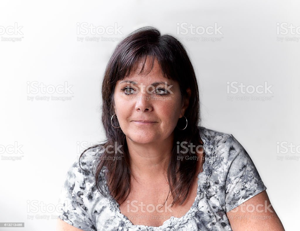Happy Middle Aged Woman Smiling stock photo