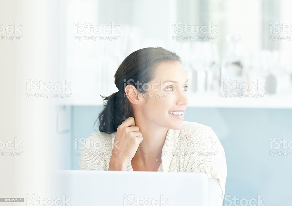 Happy middle aged woman thinking something while looking away royalty-free stock photo
