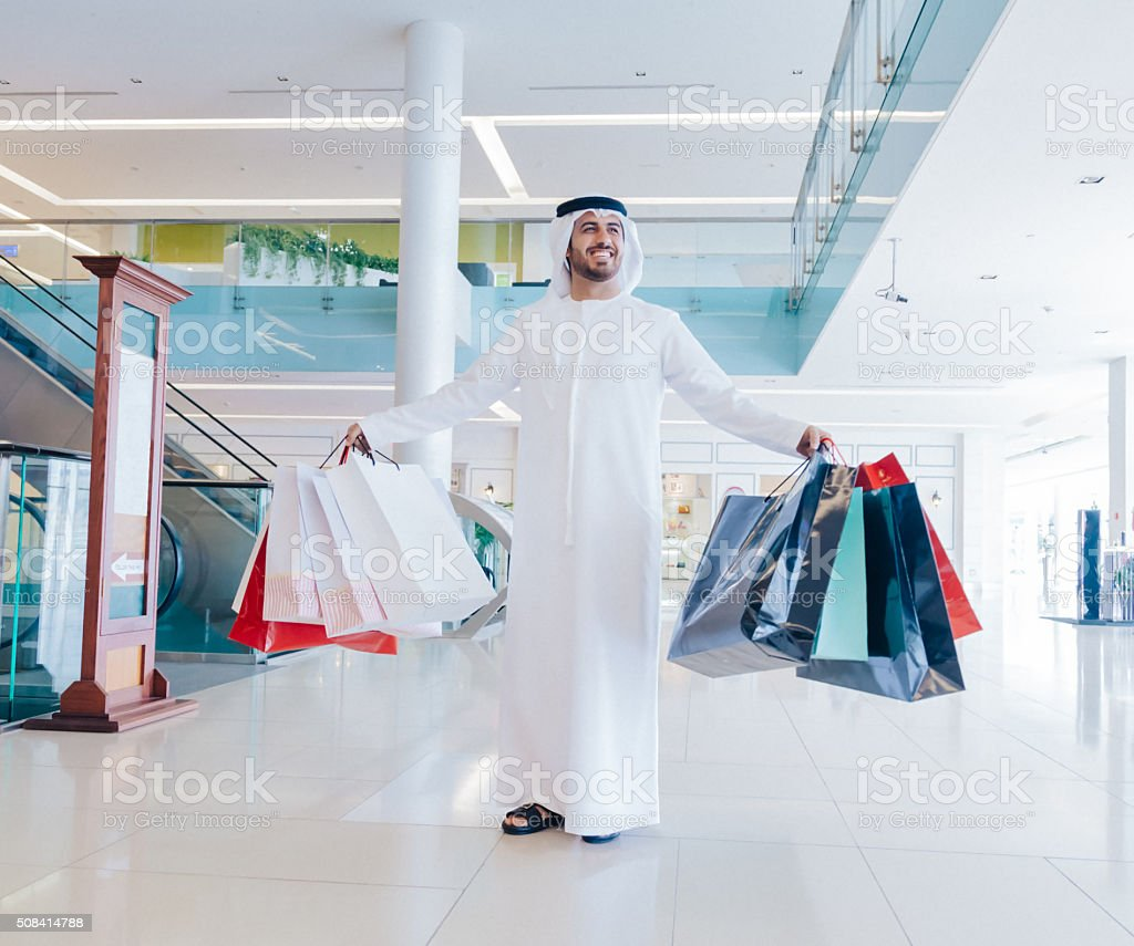 Happy Middle Eastern Man with Shopping Bags stock photo