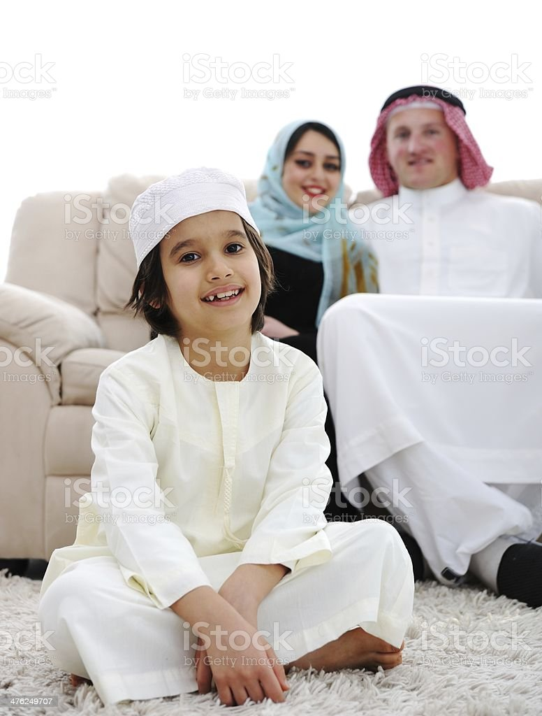 Happy Middle eastern on sofa royalty-free stock photo