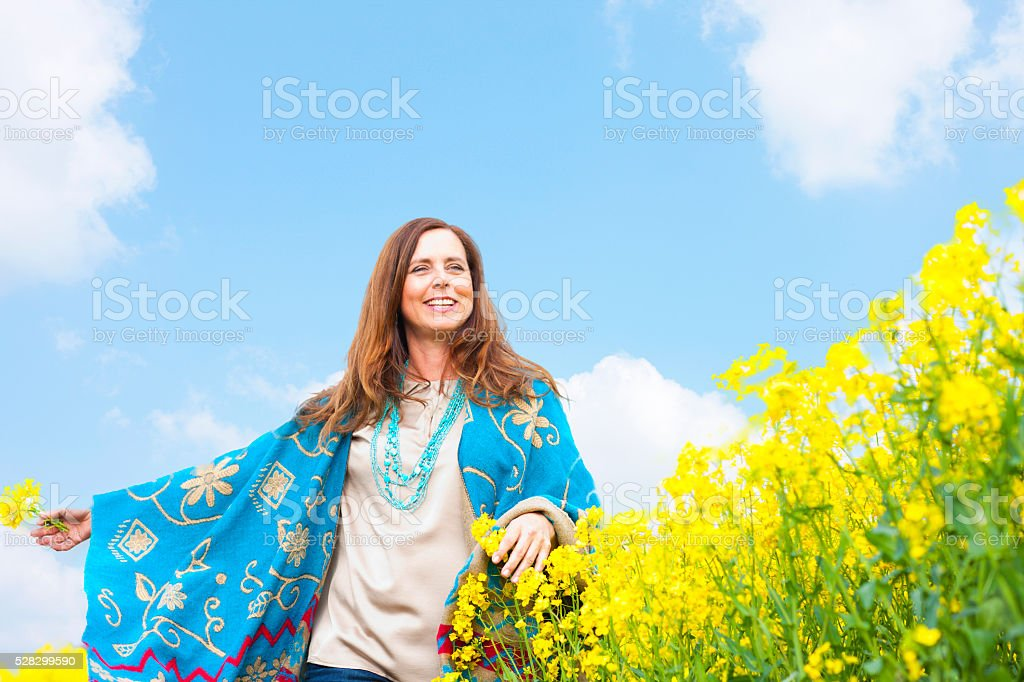 Happy middle scent woman in flower field stock photo