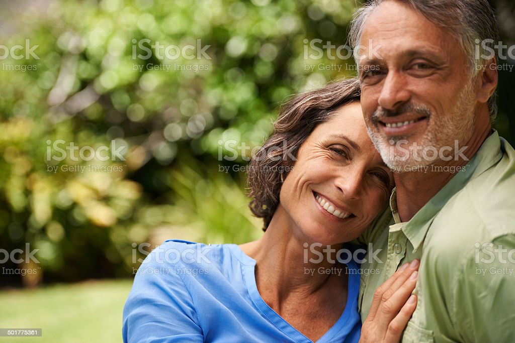 Happy, middle-aged couple embracing royalty-free stock photo