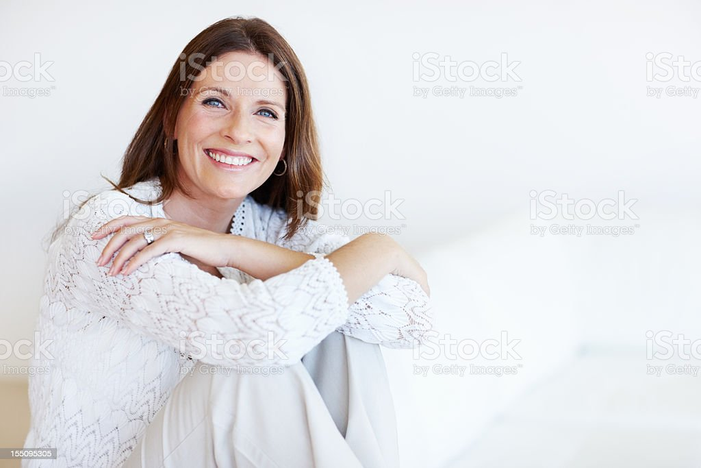 Happy middle-aged woman relaxing stock photo