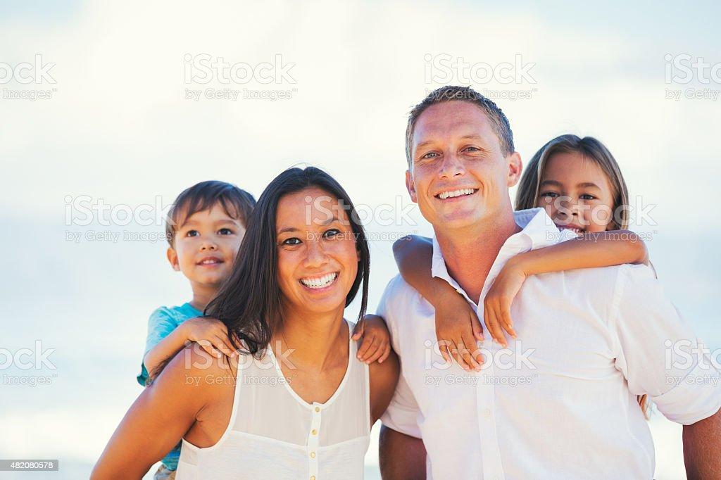 Happy Mixed Race Family Having Fun Outdoors stock photo