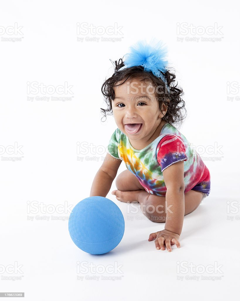 Happy Mixed Race Toddler Girl Playing With Blue Ball royalty-free stock photo