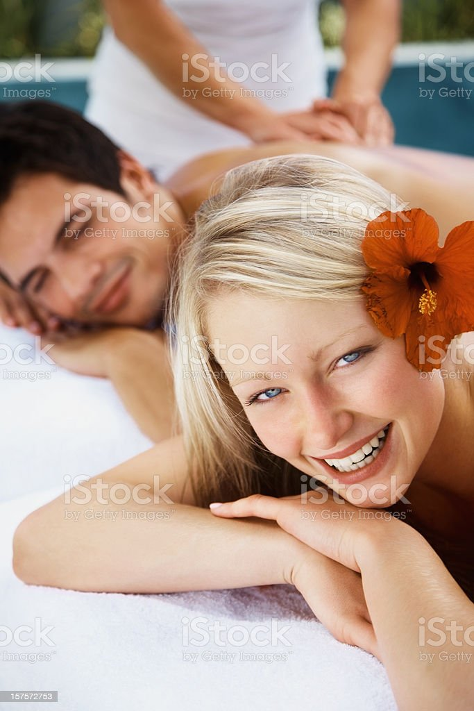 Happy modern couple receiving a body massage at day spa royalty-free stock photo