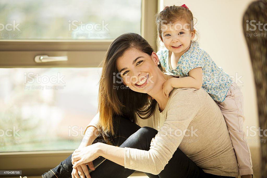 Happy mom and her baby girl stock photo