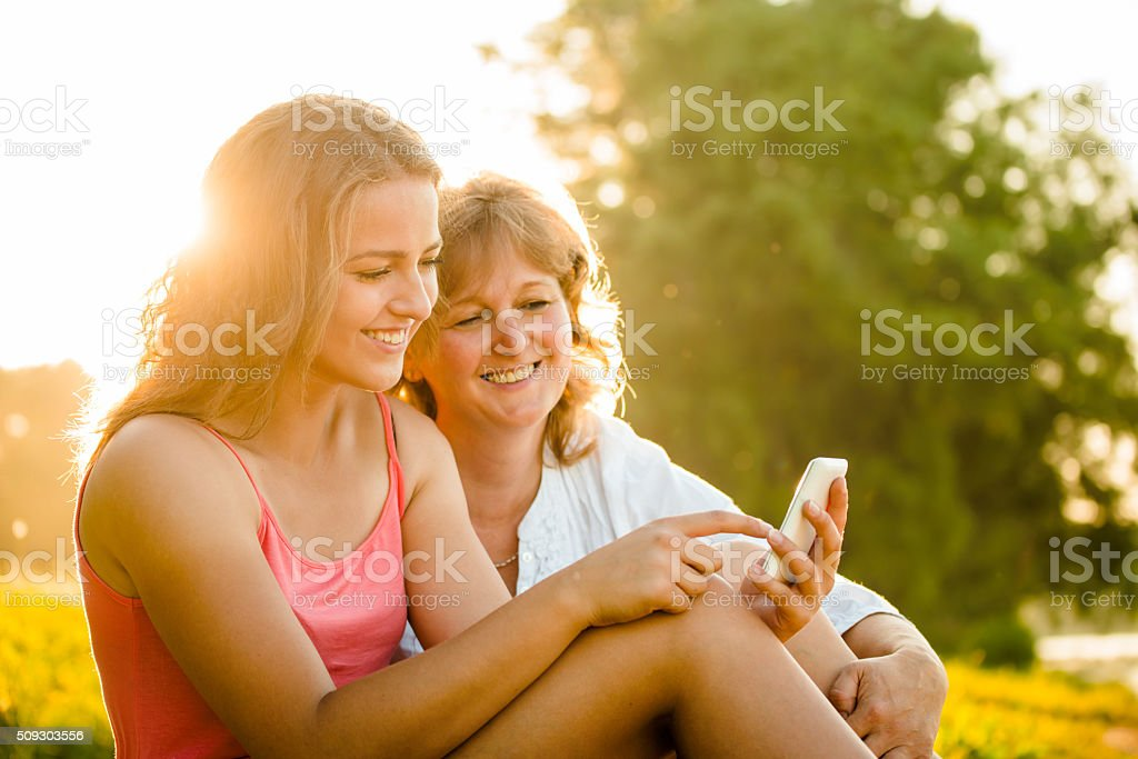 Happy moments together - mother and daughter stock photo
