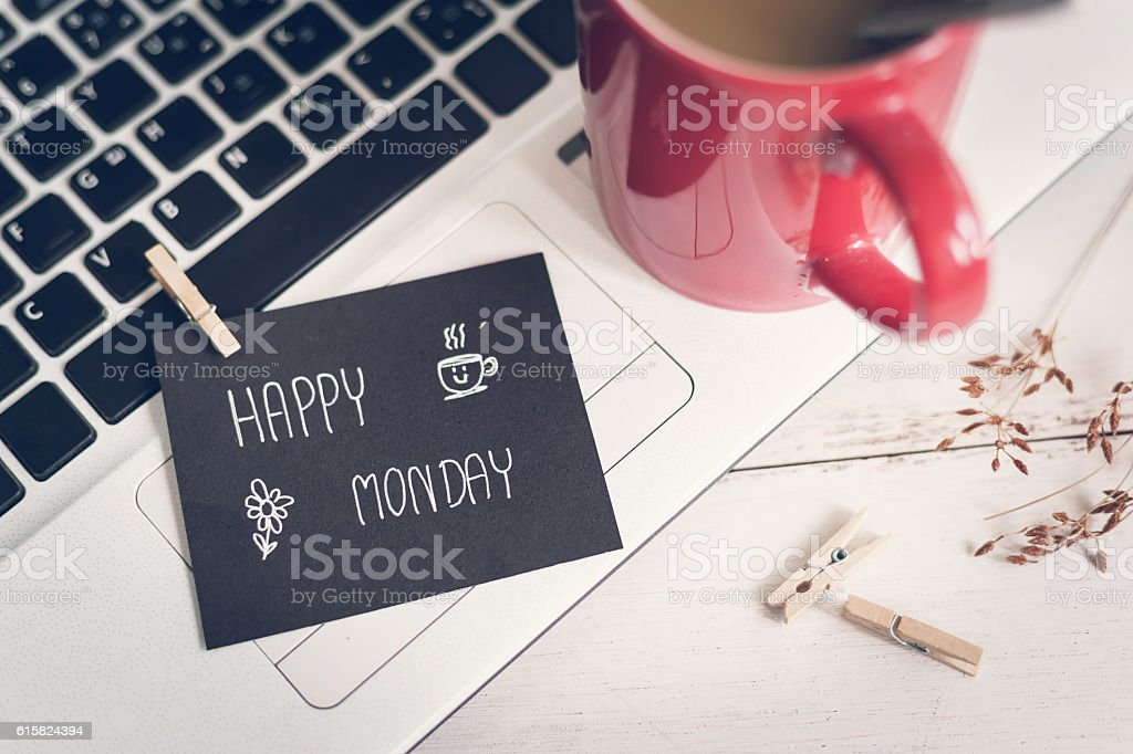 Happy Monday massage on notebook with coffee stock photo