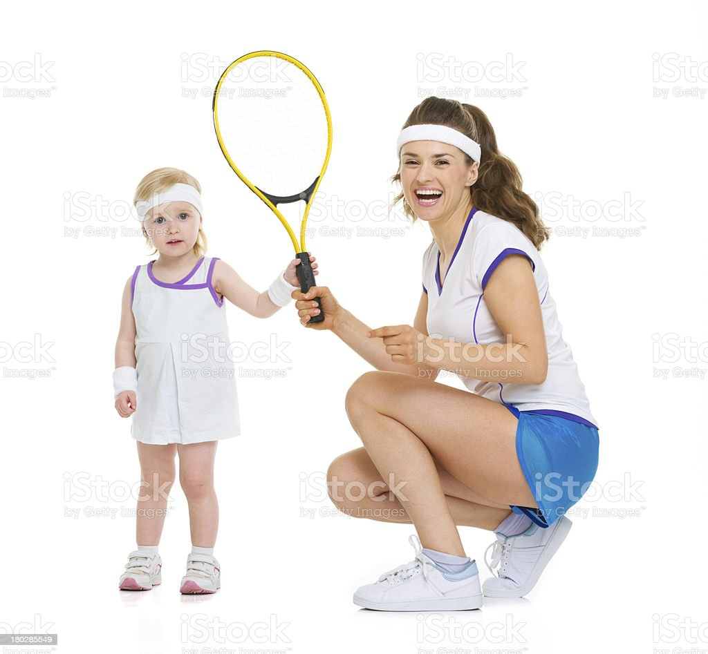 Happy mother and baby holding tennis racket royalty-free stock photo