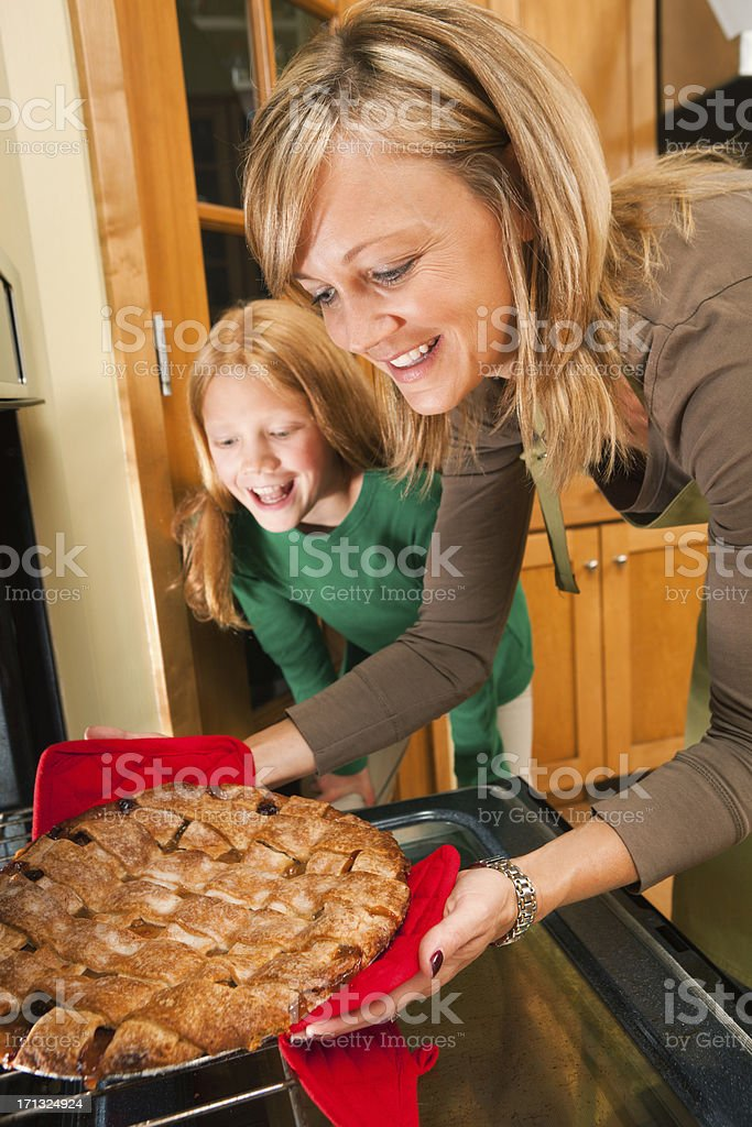 Happy Mother and Daughter Baking Thanksgiving Apple Pie Desert royalty-free stock photo