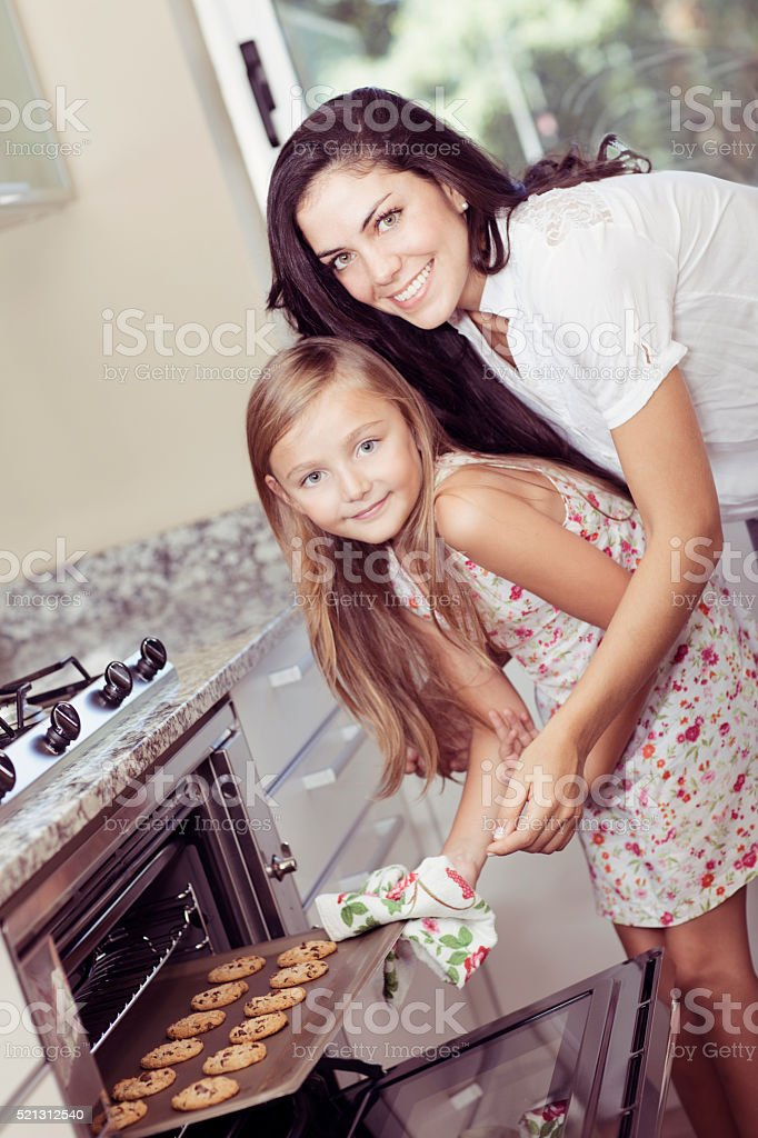 Happy Mother and Daughter Cooking stock photo