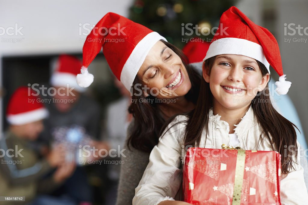 Happy mother and daughter holding a Christmas present royalty-free stock photo
