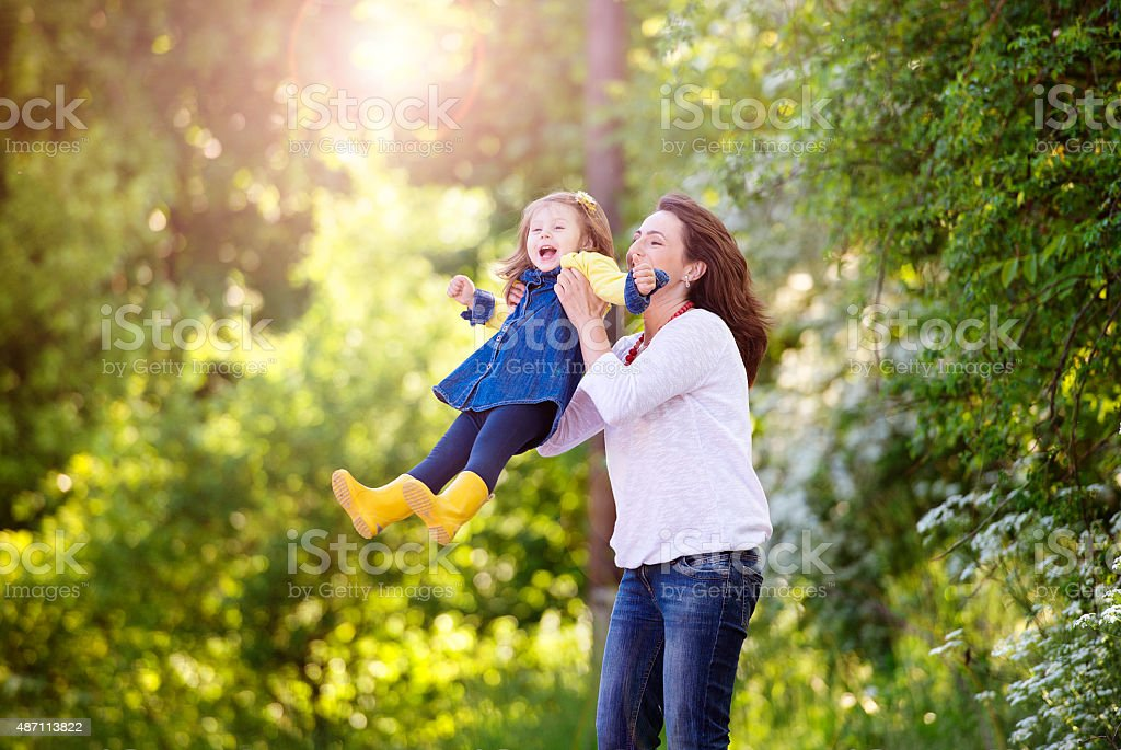 Happy mother and daughter in nature stock photo