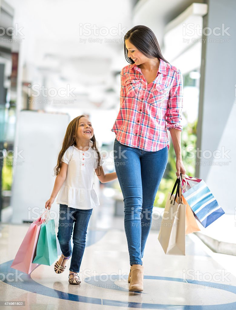 Happy mother and daughter shopping stock photo