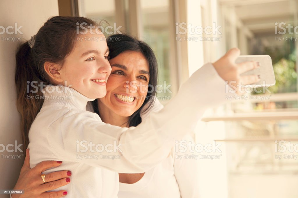 Happy Mother and Daughter Taking a selfie stock photo