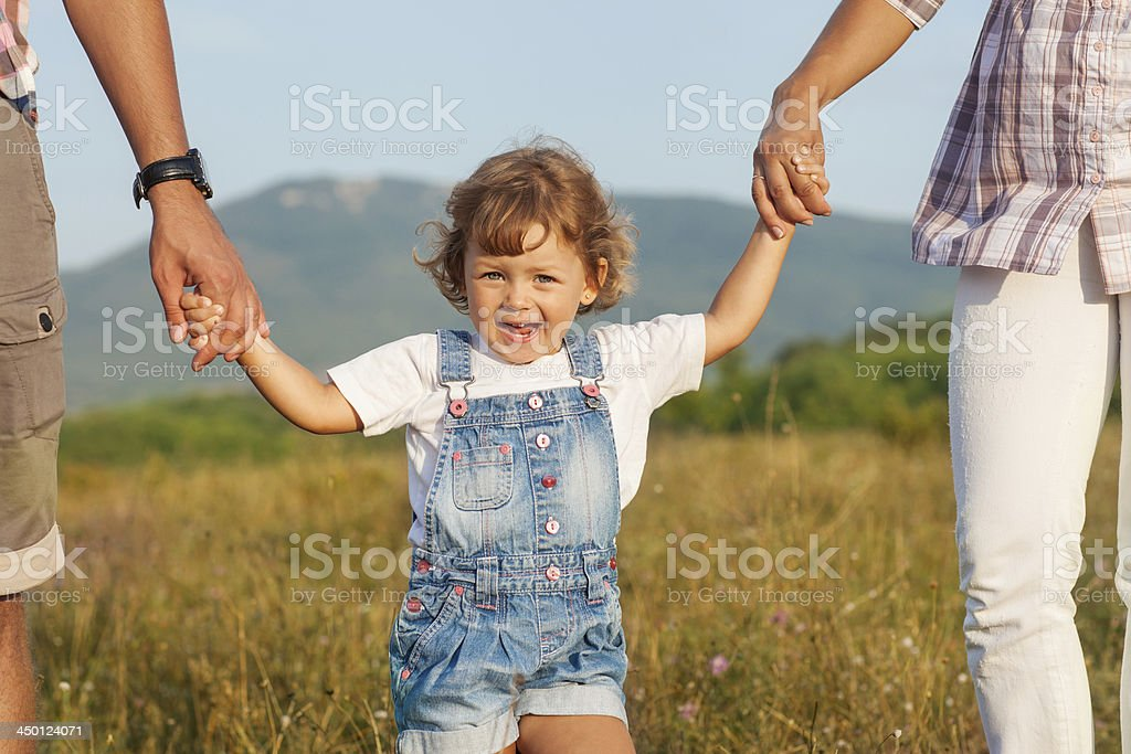 Happy mother and father with daugther royalty-free stock photo