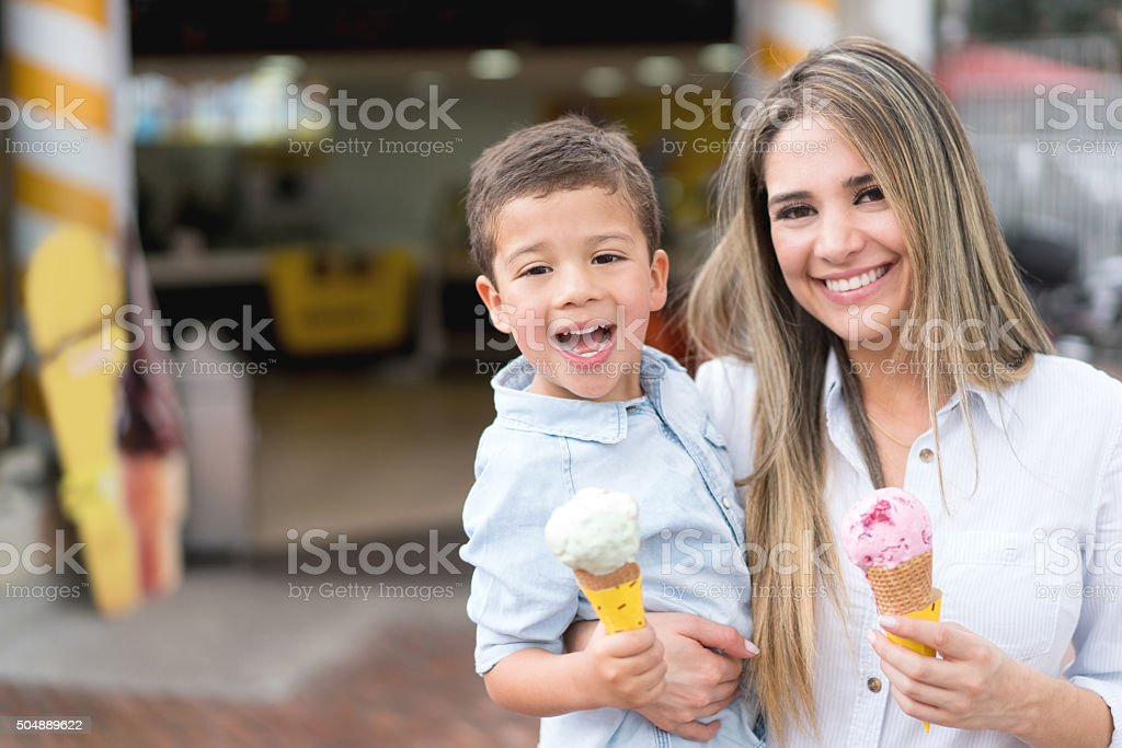 Happy mother and son eating ice cream stock photo