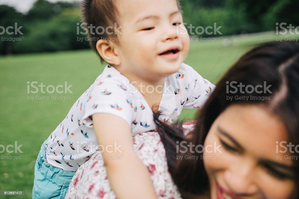 Happy mother and son having fun outdoors stock photo