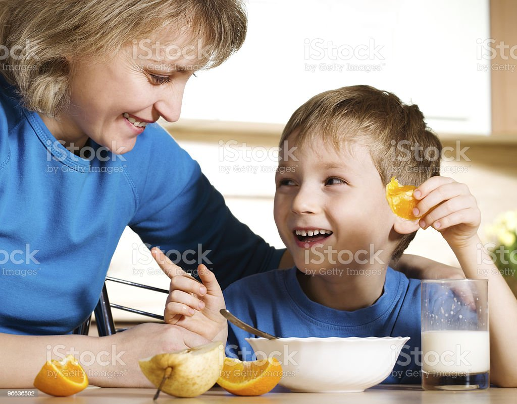 Happy mother and son in kitchen stock photo