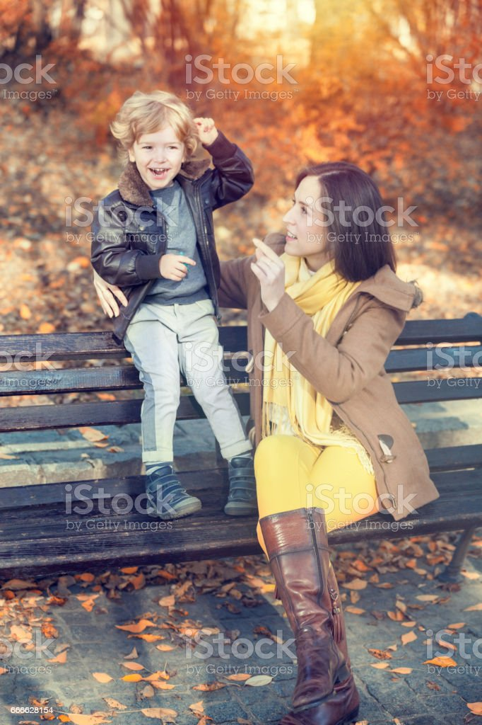 Happy mother and son in the park. stock photo