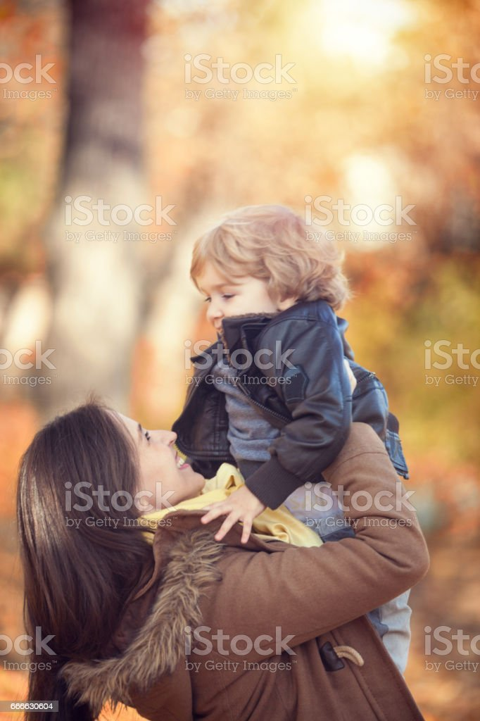 Happy mother and son playing. stock photo